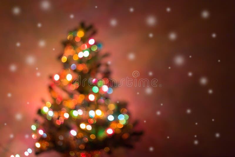 Fond de Noël, lumières defocused de bokeh de tache floue d'image photos libres de droits