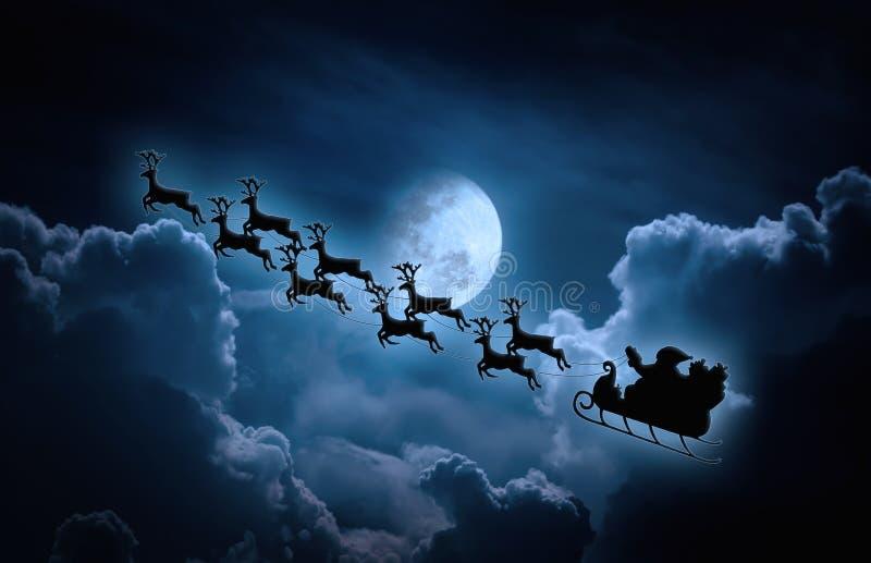 Fond de Noël Silhouette du vol de Santa Claus sur un slei images libres de droits