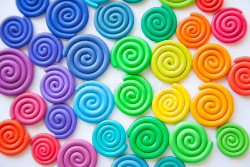 Fond de pâte à modeler Twisted a coloré des spirales de plastique de photographie stock libre de droits