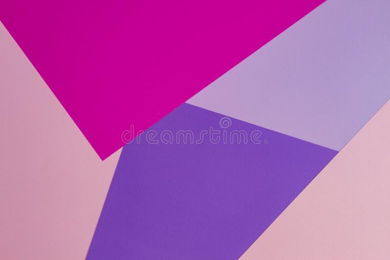 Fond de papier coloré avec des tons roses, pourpres, violets images stock