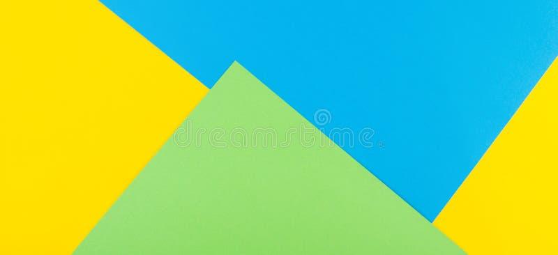 Fond de papier géométrique abstrait Couleurs jaunes, bleues et vertes photographie stock