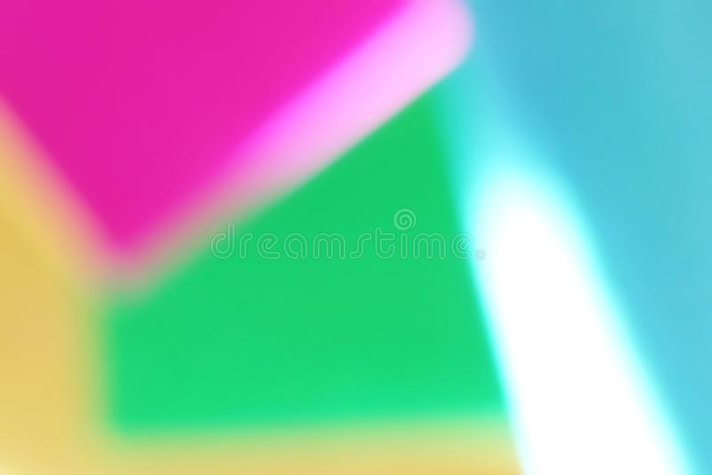 Fond de papier géométrique d'effet defocused blured par résumé Couleurs au néon de mode de tendance photo stock