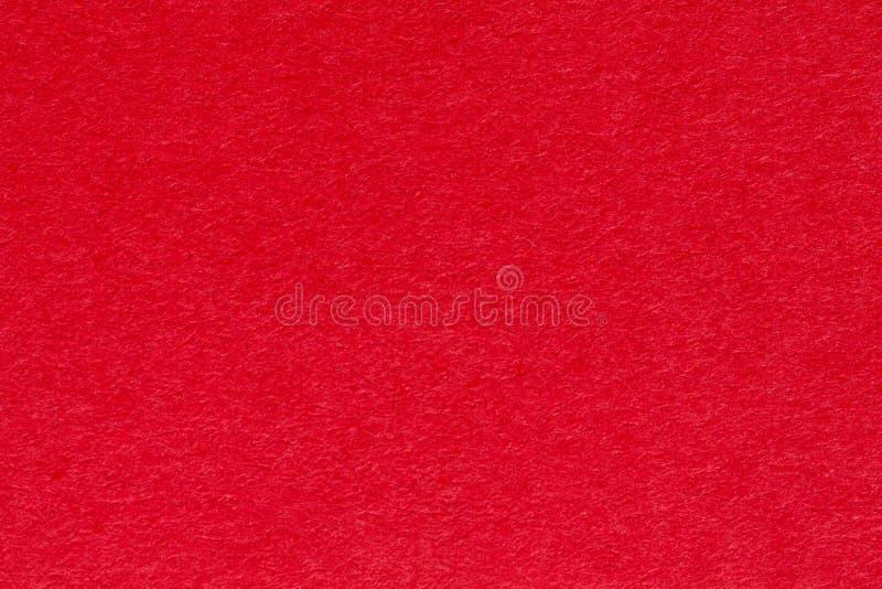 Fond de papier rouge, bons lumineux pour les décorations et le métier photos libres de droits