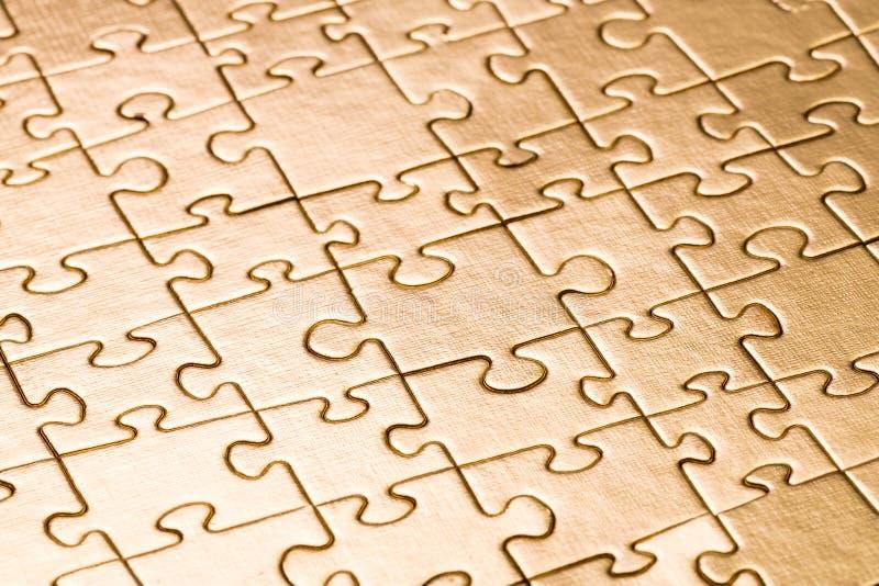 Fond de puzzle d'or photo libre de droits