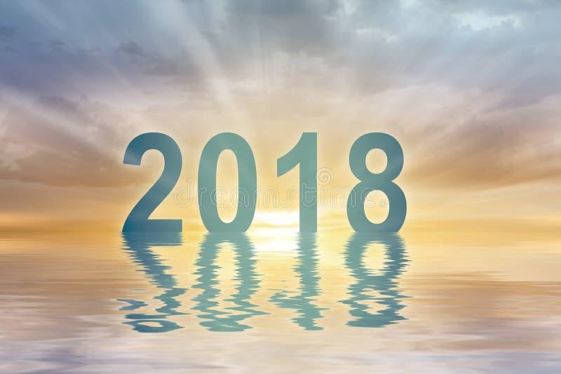 Fond de tache floue de coucher du soleil des textes de chiffres de la nouvelle année 2018 photo stock