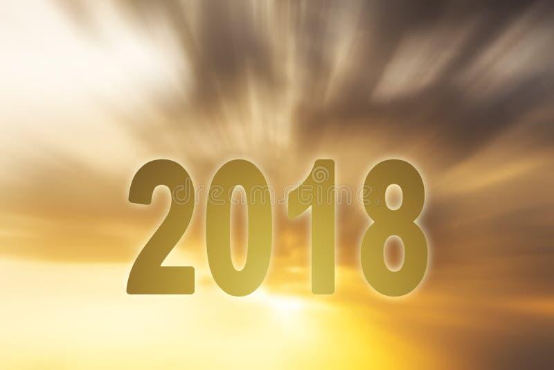 Fond de tache floue de coucher du soleil des textes de chiffres de la nouvelle année 2018 images libres de droits
