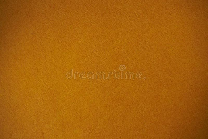 Fond de texture de feutre d'orange le textile tissé d'isolement images stock