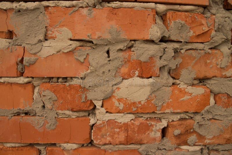 Fond de texture de mur de briques de fente photo stock