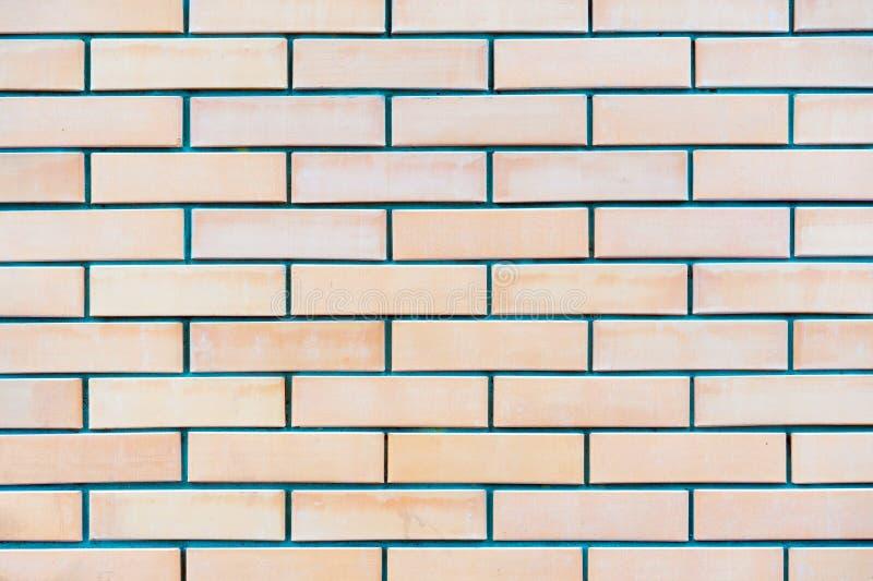 Fond de texture peinte rouge de couleur claire de modèle de mur de briques photographie stock libre de droits