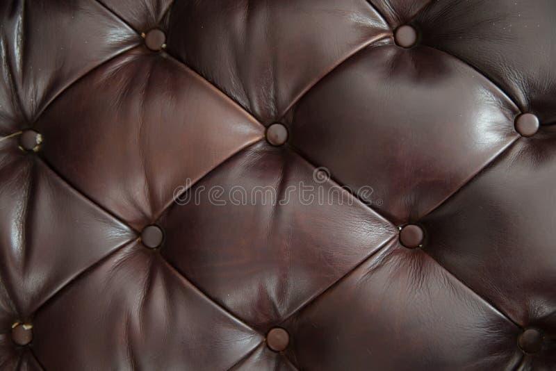Fond de texture de sofa de cuir de Brown images libres de droits
