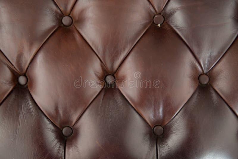 Fond de texture de sofa de cuir de Brown images stock