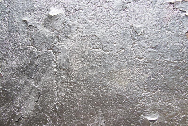 Fond de textures de stuc Fragment d'un vieux mur avec la peinture argentée Place pour le texte photo libre de droits