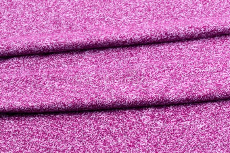Fond de tissu d'une manière ordonnée plié de pourpre ou de Bourgogne photos stock