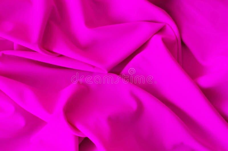 Fond de tissu de satin de couleur rose photo stock