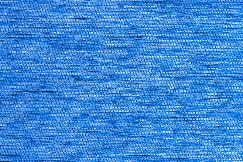 Fond dense de tissu de duvet dur court plat bleu, fin sans tout flou photos libres de droits