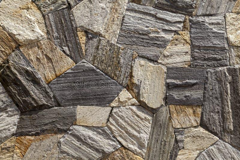 Fond des dalles en pierre sur le mur d'un bâtiment photographie stock
