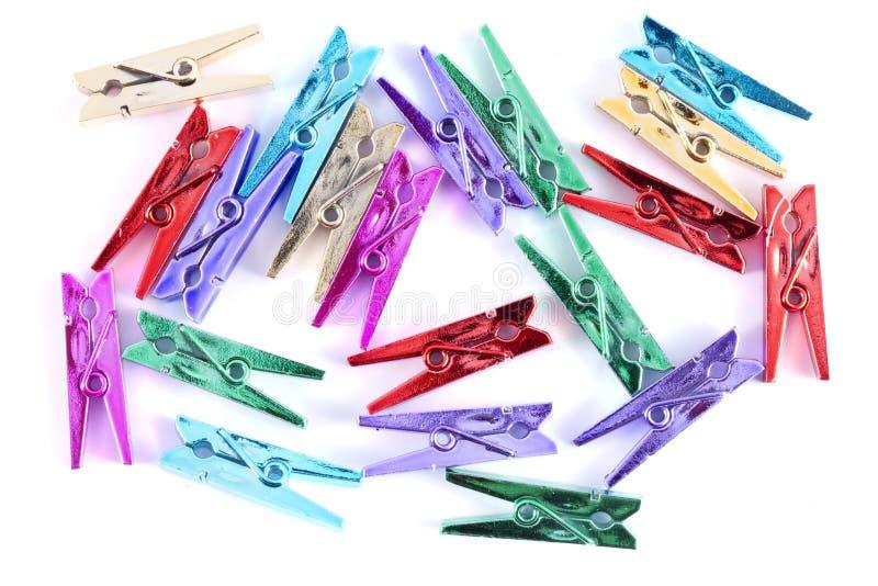 Fond des pinces à linge multicolores photo stock