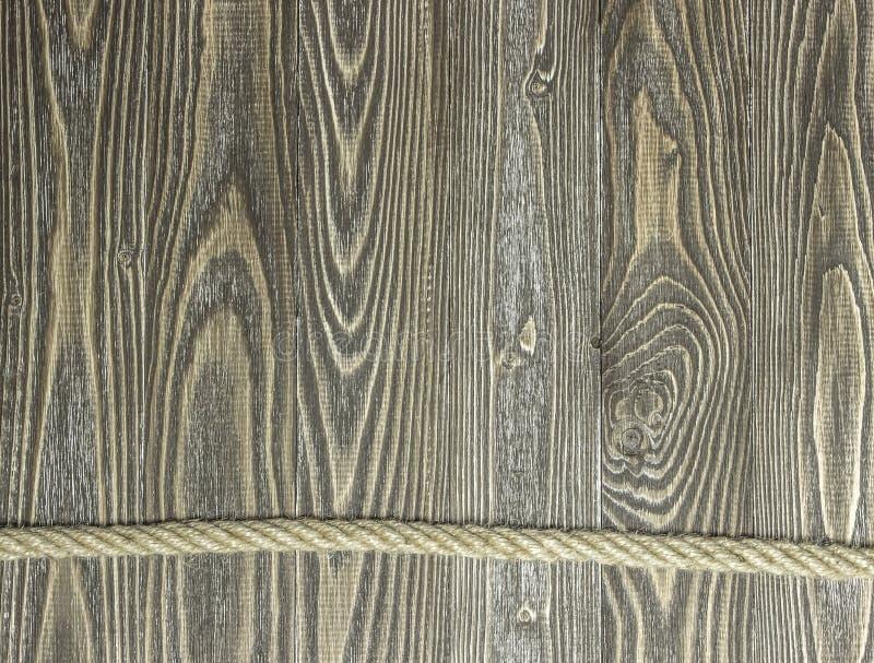 Fond des planches et de la corde texturisées de pin sur les planches en bois image stock