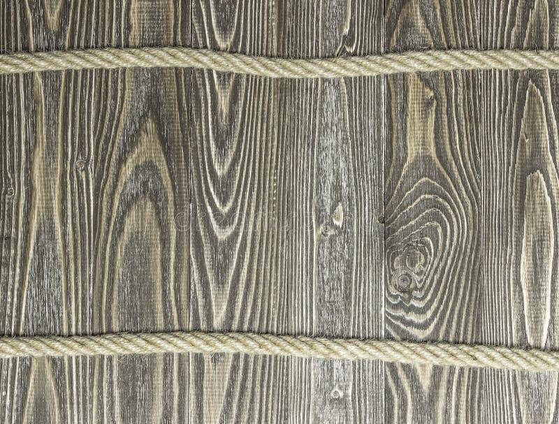 Fond des planches et de la corde texturisées de pin sur les planches en bois photo libre de droits
