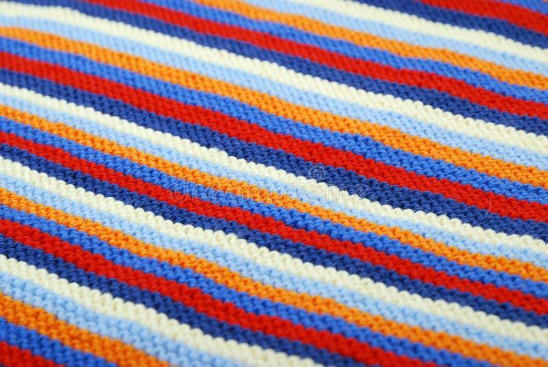 Fond diagonal rayé de tissu tricoté. photos libres de droits