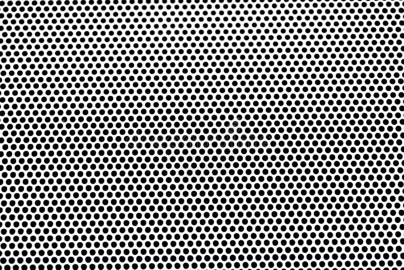 Fond discordant en aluminium de texture De plaque métallique avec des trous photo stock
