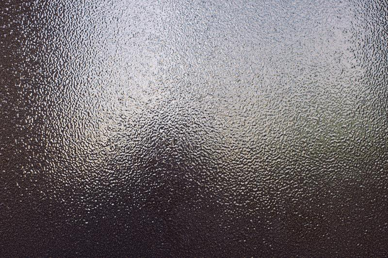 Fond du métal texturisé en bronze brun qui scintille dans la lumière image libre de droits