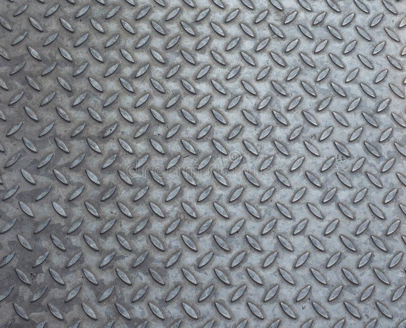 Fond en acier gris de plat de diamant photos libres de droits