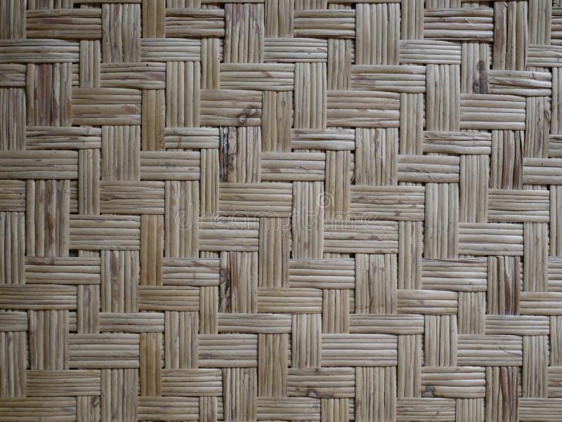 Fond en bambou naturel de tapis plat tiss? par bambou photo libre de droits