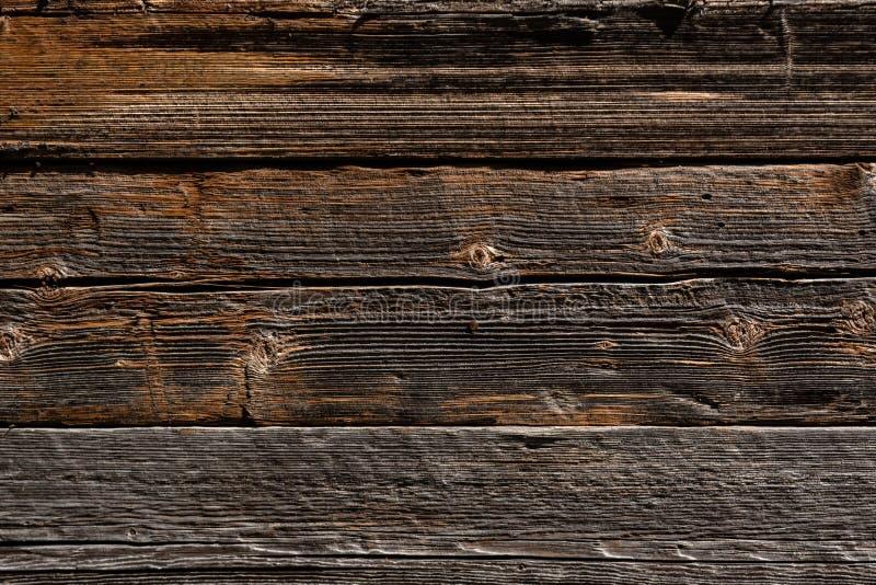 Fond en bois de parquet de brun foncé avec des fissures et des fentes image libre de droits