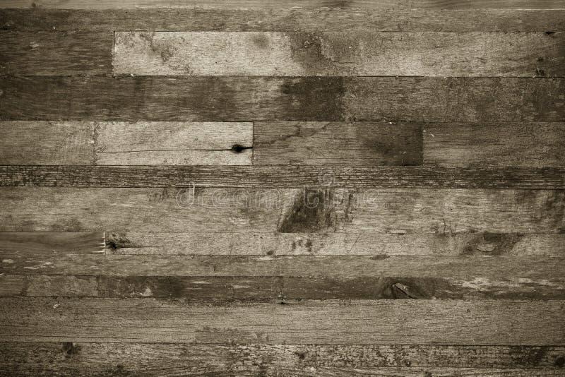 Fond en bois des extrémités de vieux conseils toned image stock