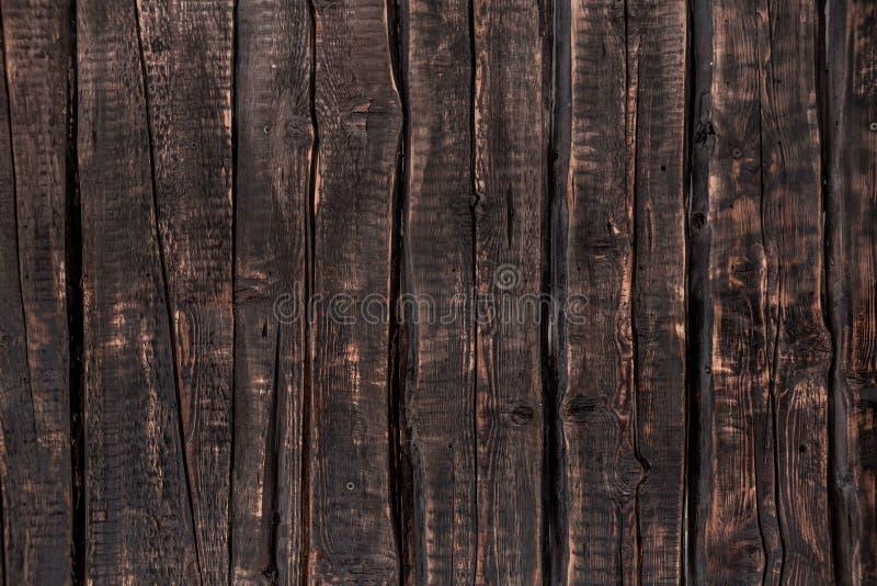 Fond en bois foncé, texture approximative images stock