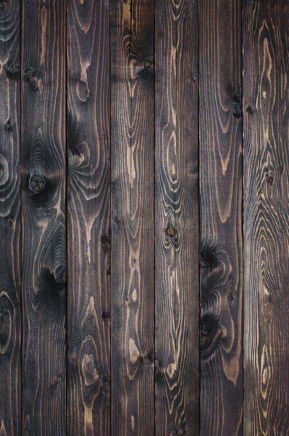 Fond en bois fonc? fait d'un conseil ?troit images libres de droits