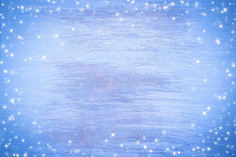 Fond en bois peint par bleu avec des flocons de neige Fond de Noël images libres de droits