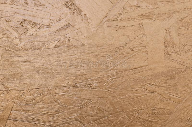 Fond en bois texturisé d'or brillant images stock