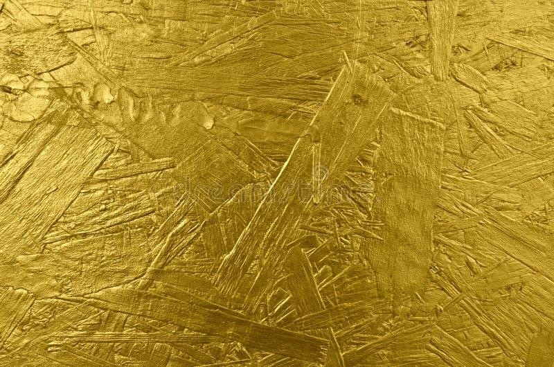 Fond en bois texturisé d'or brillant photo libre de droits