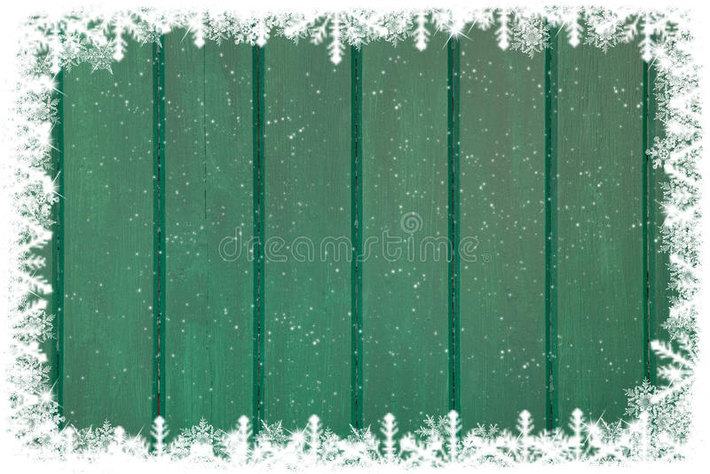 Fond en bois vert avec la neige et flocons de neige pour Noël photo libre de droits