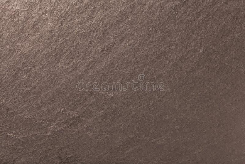 Fond en bronze foncé d'ardoise naturelle Texture de pierre image stock