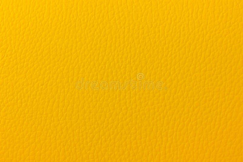 Fond en cuir jaune image stock