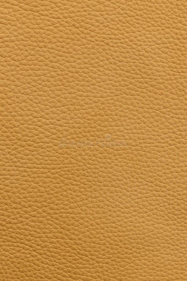 Fond en cuir jaune photographie stock