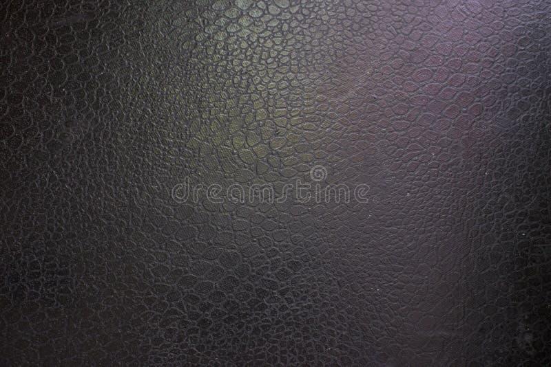 Fond en cuir noir avec le rose et le point culminant vert photos libres de droits