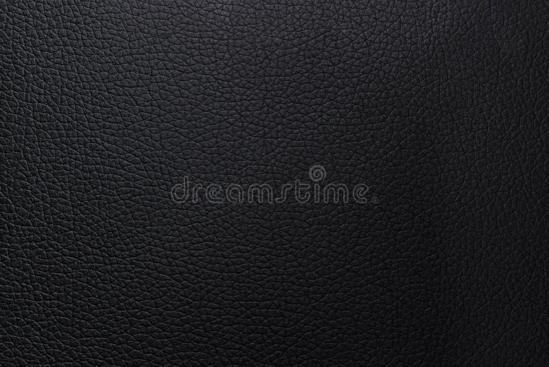 Fond en cuir noir de texture Modèle matériel d'abrégé sur portefeuille de plan rapproché ou peau d'animal cognée de luxe image stock