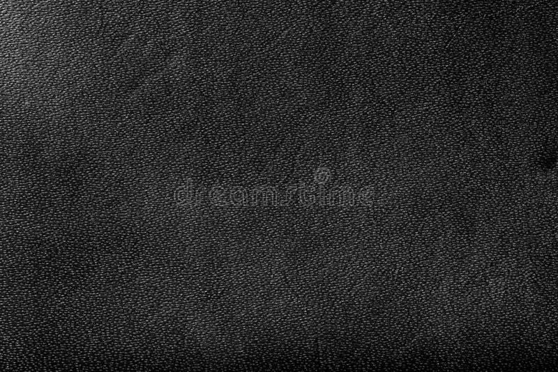 Fond en cuir noir véritable, modèle photographie stock