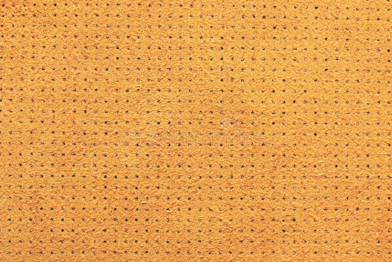 Fond en cuir perforé de texture de velours jaune image libre de droits