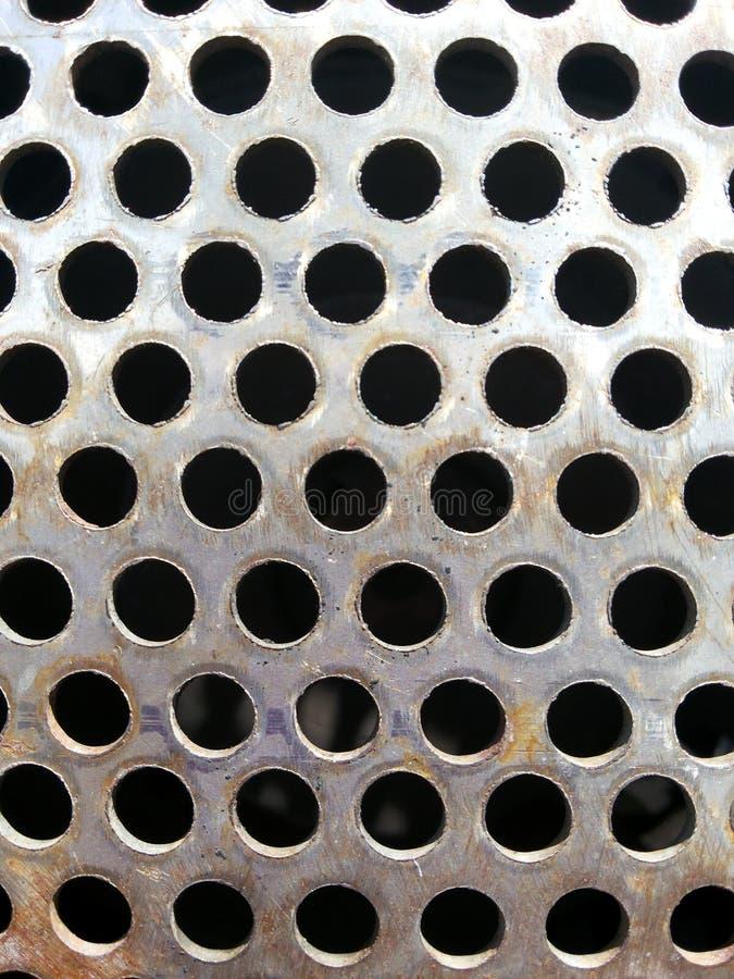 Fond en métal de trou photographie stock libre de droits