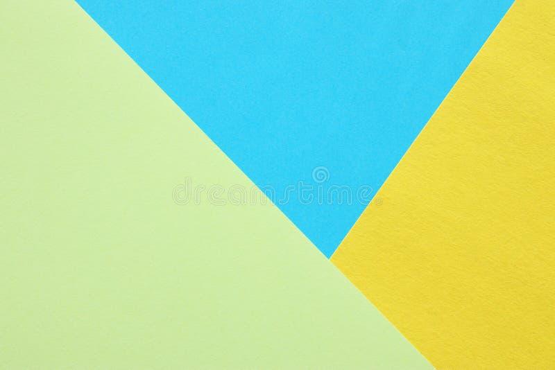 fond en pastel de trois nuances configuration plate bleue, verte et jaune, vue supérieure photos libres de droits