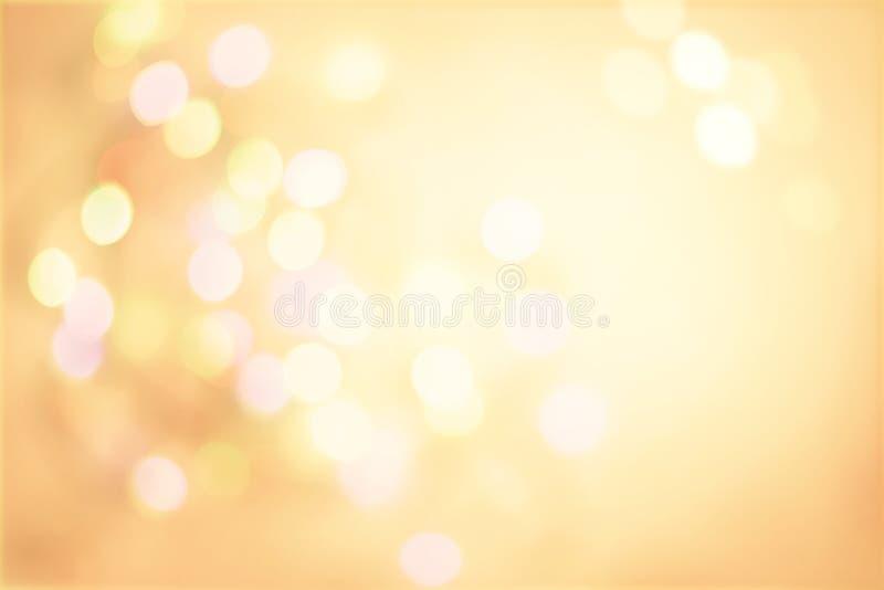 Fond en pastel de vintage d'or avec le boke léger de taches Defocused photos libres de droits