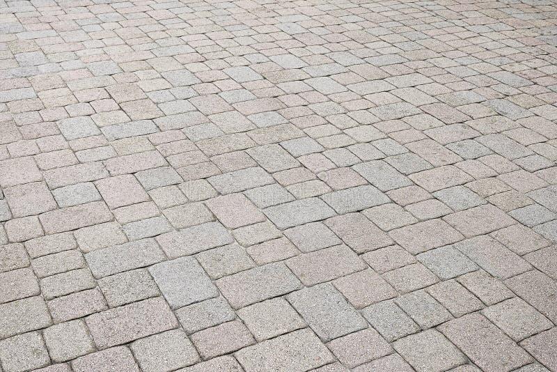 Fond en pierre coloré de trottoir images stock