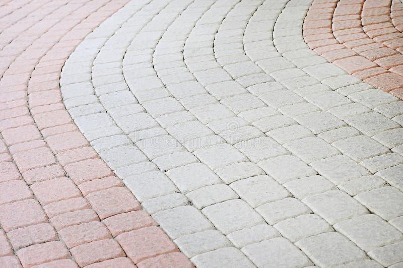 Fond en pierre coloré de trottoir photo stock