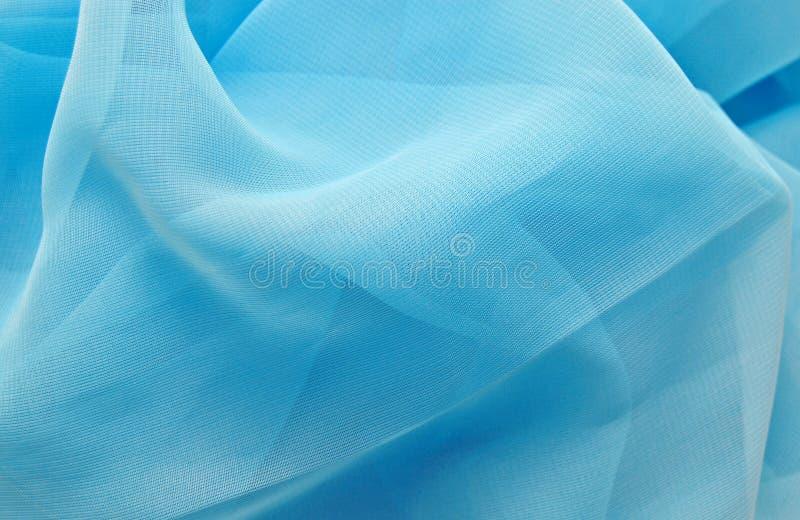 Fond en soie bleu images stock