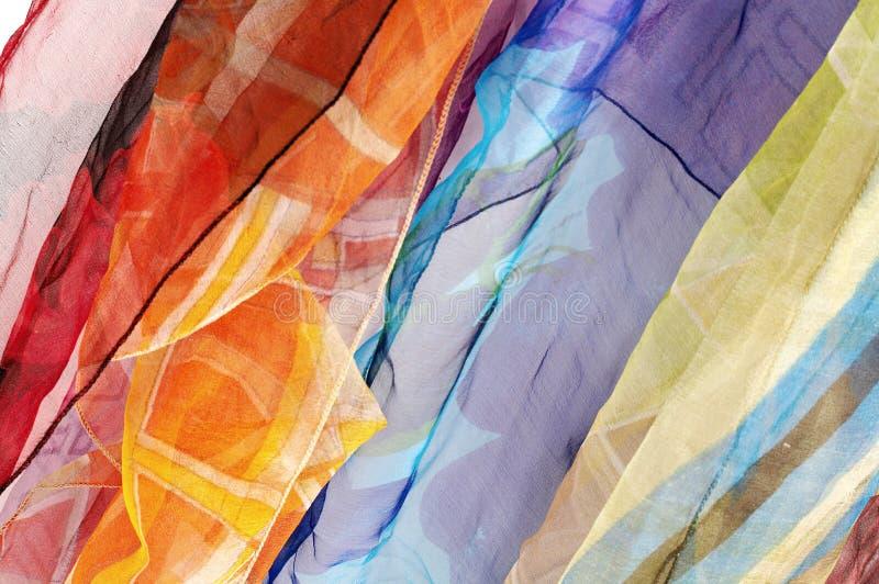 Fond en soie coloré d'écharpes photographie stock